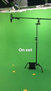 green screen on set for the Spell Tutor with boom mic