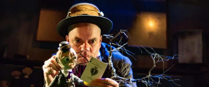 Eric Woolfe, actor, as Brimstone McReedy and the puppet version of him with a cursed playing card